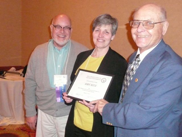Amy Ritz, one of the Golden Holtan recipients, is congratulated by Roger Bennett, Golden Holtans Chair, and by Dr. Boyd Holtan.