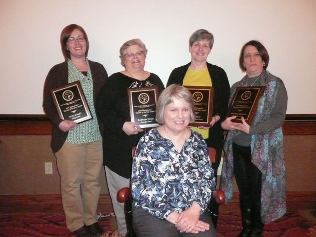 "Pictured left to right are Dr. Vicki Sealey, the 2017 College/University Mathematics Teacher of the Year, Barbara Zingg, the 2017 High School Mathematics Teacher of the Year, Amy Ritz, 2017 Middle School Mathematics Teacher of the Year, and Amanda Freeman, 2017 Elementary School Mathematics Teacher of the Year.  Seated is ""The Chair"" recipient, Sheila Ruddle."